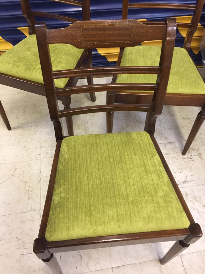 Wooden dining chair with green textile