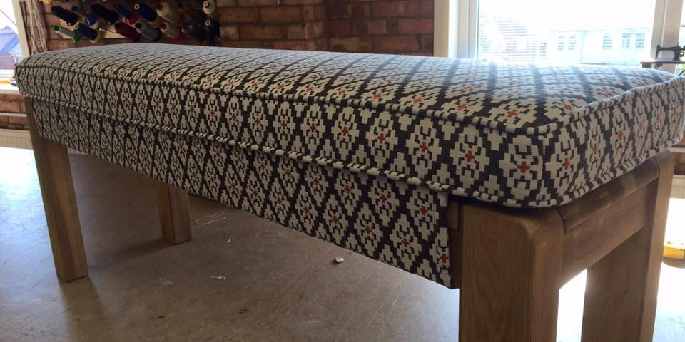 Wood bench with blue diamond patterned textile