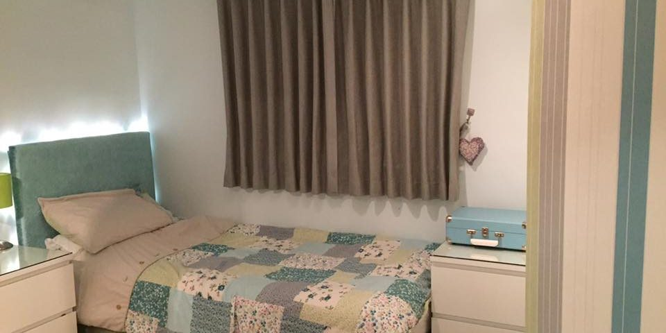 Grey curtains and patchwork quilt