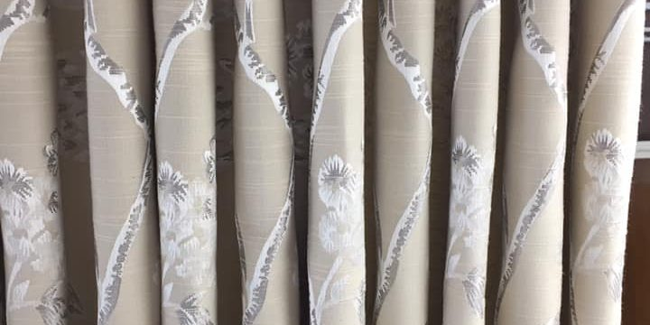 Cream curtains with plant patterns
